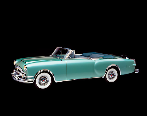 AUT 21 RK0725 03 © Kimball Stock 1953 Packard Caribbean Green Convertible 3/4 Front View Studio