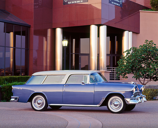 AUT 21 RK0792 02 © Kimball Stock 1955 Chevy Nomad Wagon Blue 3/4 Front View On Pavement By Building