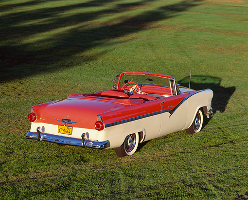 AUT 21 RK0818 07 © Kimball Stock 1956 Ford Fairlane Sunliner Convertible Red & White Overhead 3/4 Rear View On Grass