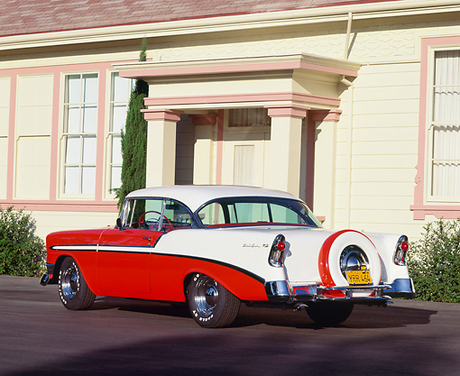 AUT 21 RK0834 04 © Kimball Stock 1956 Chevy Bel Air Red And White 3/4 Rear View On Pavement In Front Of House