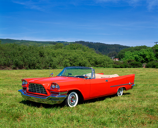 AUT 21 RK0906 05 © Kimball Stock 1957 Chrysler 300 C Convertible Gougan Red 3/4 Front View On Grass