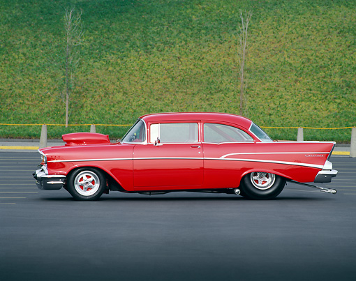 AUT 21 RK0932 08 © Kimball Stock 1957 Pro Street Chevrolet Red Profile On Pavement By Green Hill
