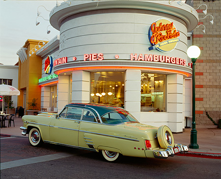 AUT 21 RK0945 04 © Kimball Stock 1954 Mercury Monterey Sun Valley 3/4 Rear View On Pavement In Front Of Diner At Dusk