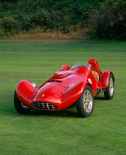 AUT 21 RK1028 01 © Kimball Stock 1955 Bandini Siluro Red Racing Car 3/4 Front View On Grass