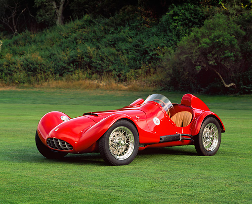 AUT 21 RK1029 02 © Kimball Stock 1955 Bandini Siluro Red Racing Car 3/4 Side View On Grass