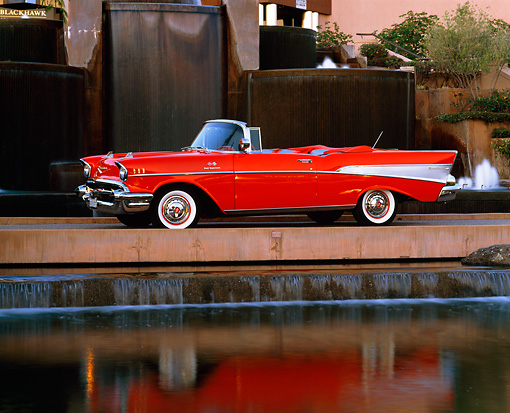 AUT 21 RK1061 07 © Kimball Stock 1957 Chevy Bel Air Convertible Red 3/4 Side View By Water Fountain