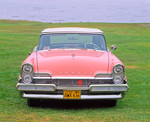 AUT 21 RK1084 01 © Kimball Stock 1957 Lincoln Premier Convertible Bermuda Coral Head On Shot On Grass