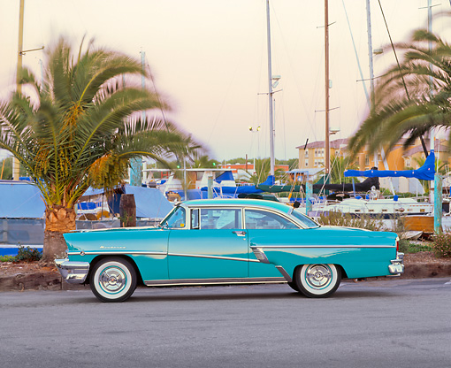 AUT 21 RK1085 02 © Kimball Stock 1956 Mercury Monterey Hardtop Green Side View On Pavement By Boat Harbor