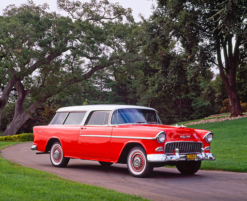 AUT 21 RK1099 02 © Kimball Stock 1955 Chevy Nomad Wagon Red White Top 3/4 Front View On Pavement By Trees And Grass