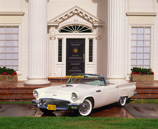 AUT 21 RK1100 02 © Kimball Stock 1957 Ford T-Bird Convertible White 3/4 Front View On Driveway In Front Of House