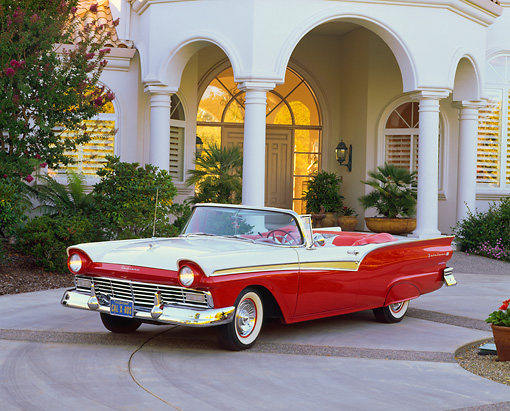 AUT 21 RK1107 08 © Kimball Stock 1957 Ford Fairlane 500 Convertible 3/4 Red/White Front 3/4 View On Driveway By House