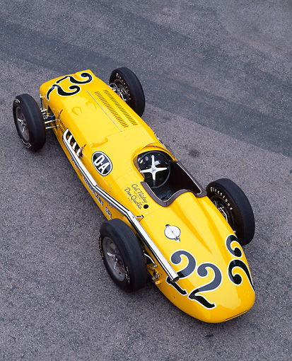 AUT 21 RK1131 05 © Kimball Stock 1953 Kurtis 500B Indy Roadster Yellow Overhead 3/4 Front View On Pavement