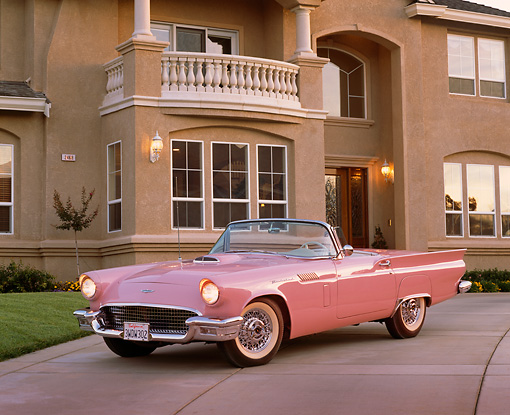 AUT 21 RK1156 09 © Kimball Stock 1957 Ford Thunderbird Convertible Pink 3/4 Front View On Driveway By House
