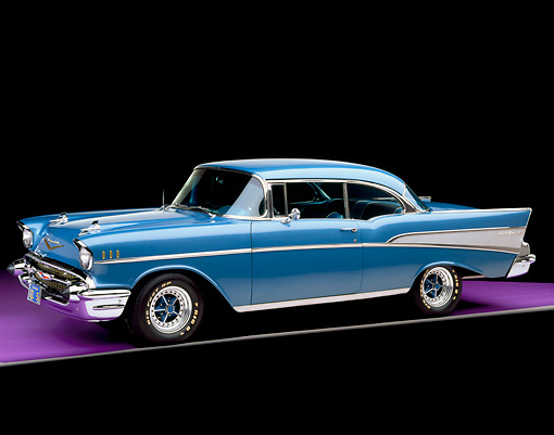AUT 21 RK1160 10 © Kimball Stock 1957 Chevy Bel Air Harbor Blue 3/4 Side View On Purple Floor Gray Line Studio