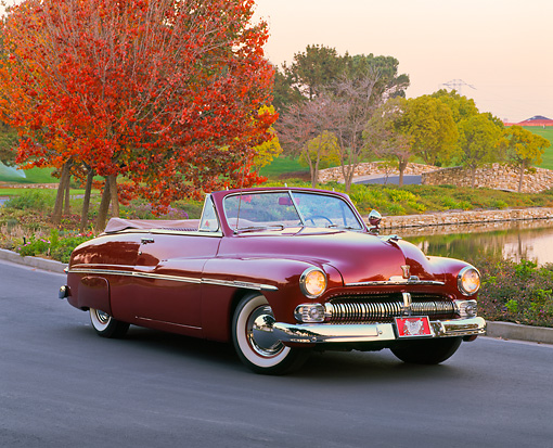 AUT 21 RK1166 01 © Kimball Stock 1950 Mercury Convertible Dark Red 3/4 Front View On Pavement By Fall Trees And Water