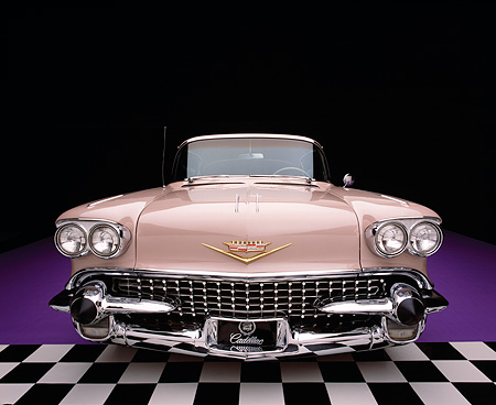AUT 21 RK1212 01 © Kimball Stock Wide Angle Shot Of A 1958 Cadillac De Ville Sedan Pink Head On Shot Checkerboard And Purple Floor