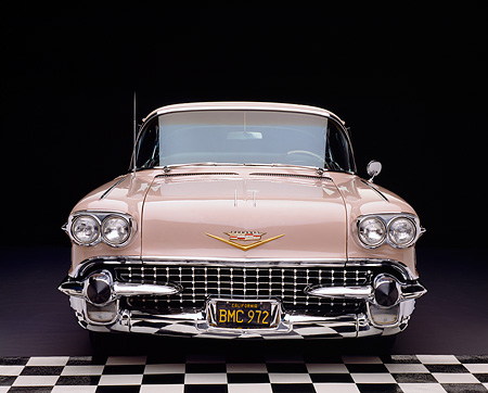 AUT 21 RK1212 19 © Kimball Stock Wide Angle Shot Of A 1958 Cadillac De Ville Sedan Pink Head On Shot Checkerboard And Purple Floor
