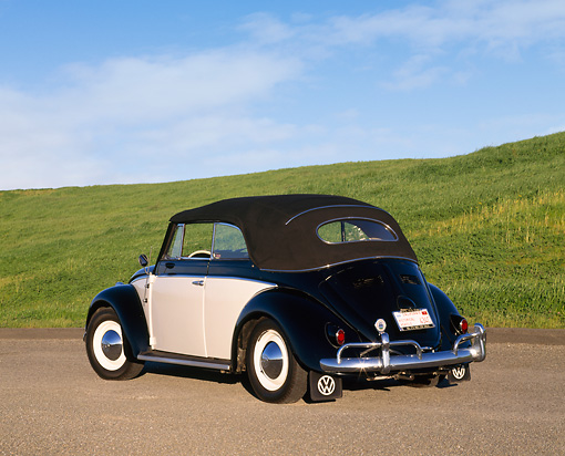 AUT 21 RK1225 02 © Kimball Stock 1958 VW Cabriolet Beetle Black And Cream 3/4 Rear View On Pavement By Grass Hills