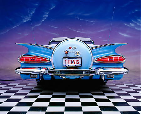 AUT 21 RK1271 04 © Kimball Stock 1959 Chevy Impala Lowrider Convertible Blue Low Rear Shot On Checkerboard Pink Clouds