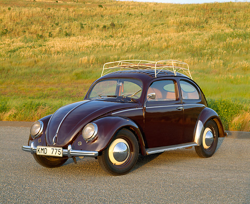 AUT 21 RK1282 02 © Kimball Stock 1950 VW Split Window Bug Wine Red 3/4 Front View On Pavement By Grass Hill