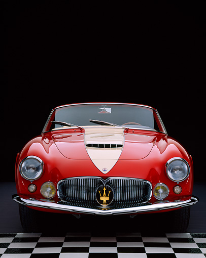 AUT 21 RK1336 04 © Kimball Stock 1957 Maserati A6G/2000 Frua Spider Red With White Stripe Head On Shot On Checkerboard Studio