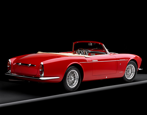 AUT 21 RK1340 04 © Kimball Stock 1957 Maserati A6G/2000 Frua Spider Red With White Stripe 3/4 Rear View On Gray Line Studio