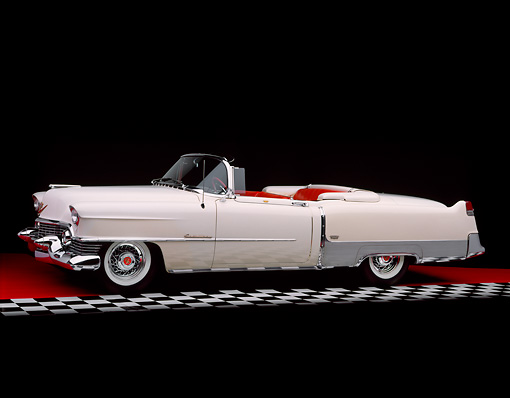 AUT 21 RK1347 06 © Kimball Stock 1954 Cadillac El Dorado Convertible White 3/4 Side View On Red Floor Checkered Line