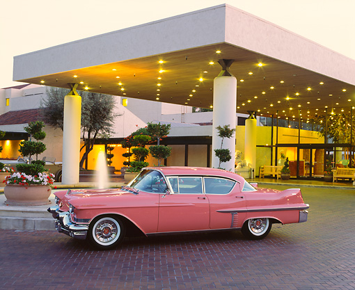 AUT 21 RK1356 05 © Kimball Stock 1957 Cadillac Pink 3/4 Side View By Building