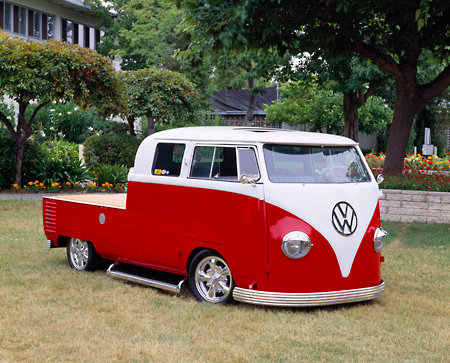 AUT 21 RK1425 03 © Kimball Stock 1959 VW Crew Cab Bus Red And White 3/4 Front View On Grass By Trees