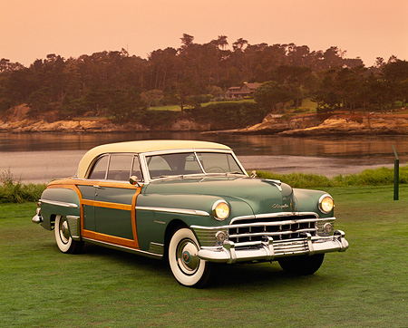 AUT 21 RK1433 04 © Kimball Stock 1950 Chrysler Town & Country Green 3/4 Front View On Grass By Water
