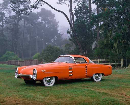 AUT 21 RK1438 02 © Kimball Stock 1955 Boano Indy Lincoln Chasis Orange Prototype 3/4 Side View On Grass By Trees Foggy