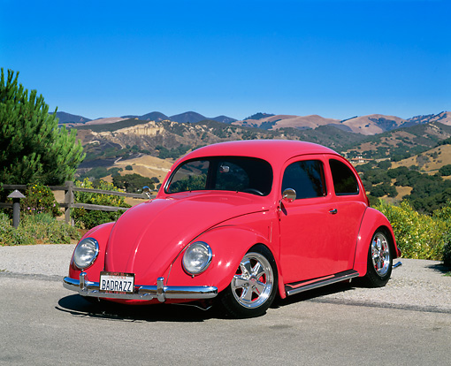 AUT 21 RK1443 07 © Kimball Stock 1955 Volkswagen Oval Window Custom Bug Raspberry 3/4 Front View On Pavement