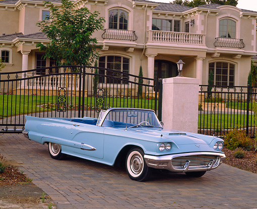 AUT 21 RK1449 01 © Kimball Stock 1959 Ford Thunderbird Convertible Light Blue 3/4 Front View On Driveway By House