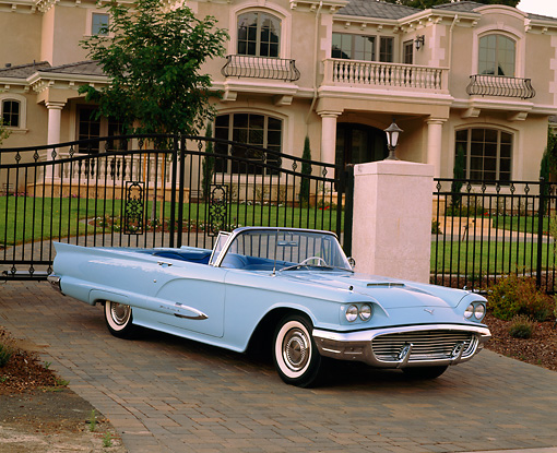 AUT 21 RK1449 03 © Kimball Stock 1959 Ford Thunderbird Convertible Light Blue 3/4 Front View On Driveway By House