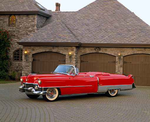 AUT 21 RK1479 01 © Kimball Stock 1954 Cadillac El Dorado Convertible Red 3/4 Side View By Garage