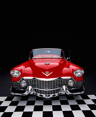 AUT 21 RK1483 01 © Kimball Stock 1954 Cadillac El Dorado Convertible Red Wide Angle Head On Checkered Floor Studio