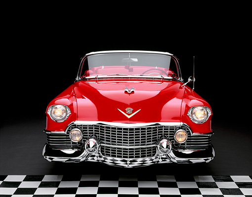 AUT 21 RK1488 03 © Kimball Stock 1954 Cadillac El Dorado Convertible Red Head On Shot Checkerboard Floor Studio