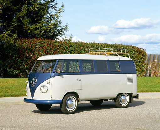 AUT 21 RK1495 05 © Kimball Stock 1959 Volkswagen Microbus Blue And White 3/4 Front View On Pavement By Trees And Bushes