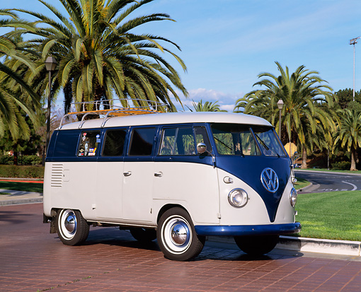 AUT 21 RK1496 02 © Kimball Stock 1956 Volkswagen Microbus Blue And White 3/4 Front View By Palm Trees