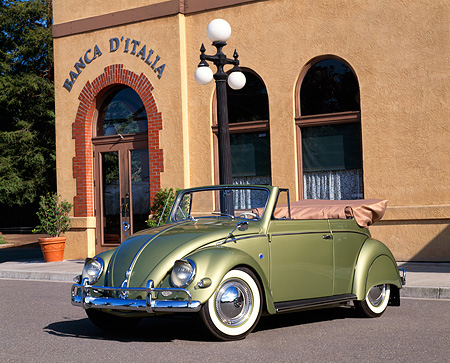 AUT 21 RK1509 03 © Kimball Stock 1956 VW Bug Convertible Green 3/4 Front View On Pavement By Building