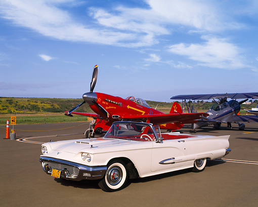 AUT 21 RK1517 07 © Kimball Stock 1959 Ford Thunderbird Convertible White 3/4 Side View With Airplane