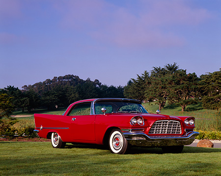 AUT 21 RK1540 02 © Kimball Stock 1957 Chrysler 300C Red 3/4 Front View On Grass By Trees Blue Sky