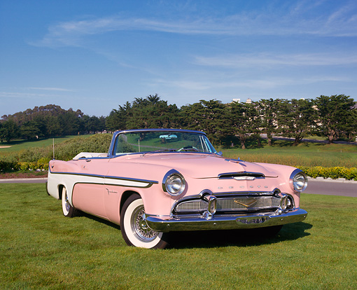 AUT 21 RK1544 06 © Kimball Stock 1956 Desoto Firedome Convertible Pink 3/4 Front View On Grass Blue Sky