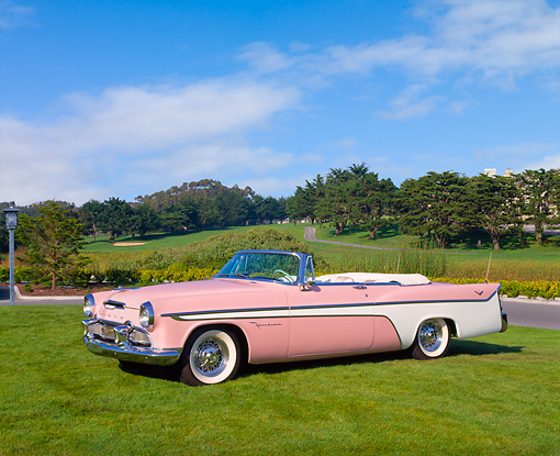 AUT 21 RK1546 02 © Kimball Stock 1956 Desoto Firedome Convertible Pink 3/4 Side View On Grass Blue Sky