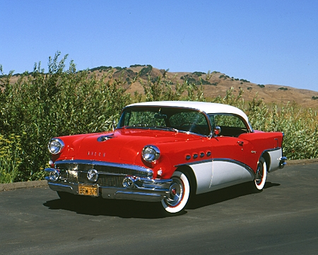 AUT 21 RK1551 03 © Kimball Stock 1956 Buick Century Red And White 3/4 Front View On Pavement Mountains
