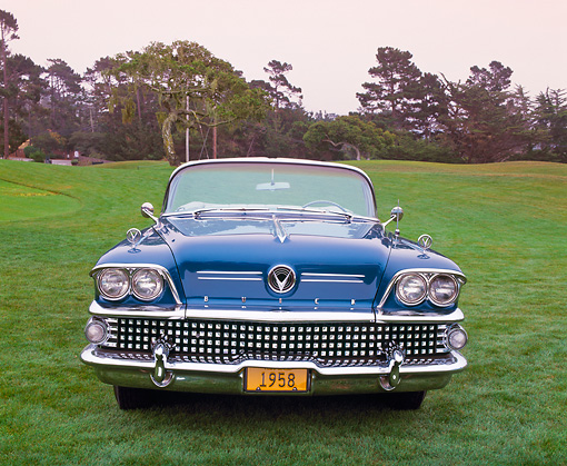 AUT 21 RK1555 01 © Kimball Stock 1958 Buick Limited Convertible Turquoise Head On Shot On Grass