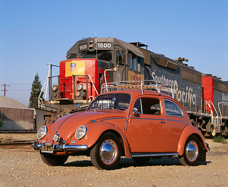 AUT 21 RK1575 04 © Kimball Stock 1958 Volkswagen Beetle Coral Low Front 3/4 View On Dirt By Train