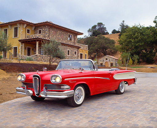 AUT 21 RK1579 02 © Kimball Stock 1958 Edsel Pacer Convertible Red And White 3/4 Front View On Driveway By House