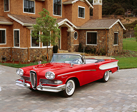 AUT 21 RK1583 05 © Kimball Stock 1958 Edsel Pacer Convertible Red And White 3/4 Front View On Driveway By House
