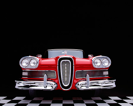 AUT 21 RK1587 20 © Kimball Stock 1958 Edsel Pacer Convertible Red And White Low Head On Shot On Checkered Floor Studio